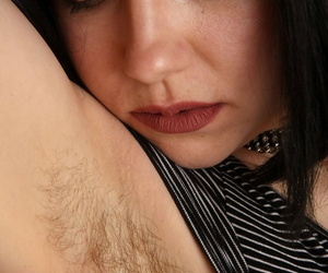Hot cutie Ruby Roxx with nice round ass reveals hairy armpits & pussy closeup