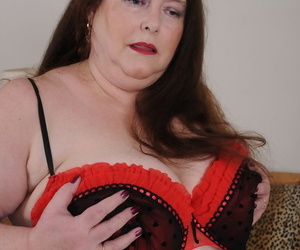 Mature BBW Debbie playing with her large natural tits & furry pussy