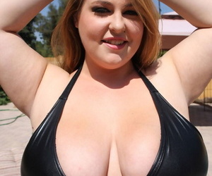 Brunette fatty Hillary Hooterz pulls out her huge natural tits in the sunshine