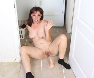 Older amateur dildos her pussy after stripping to her socks on laundry day