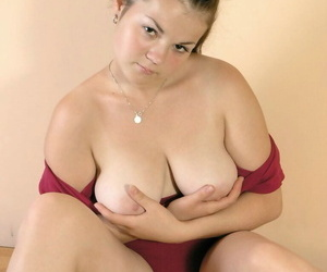 Young looking amateur plays with her big natural boobs during solo action