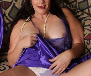 Beautiful older Sasha Karr bares her big tits and spreads nude wearing beads