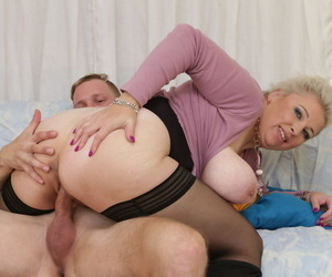 Hot older lady with giant boobs takes a facial cumshot after sex from toy boy