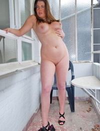 Chubby amateur pulls down her panties to pose nude on condo balcony