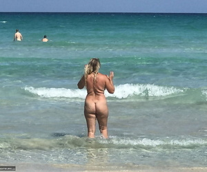 Fat mature woman Sweet Susi hangs out at the beach in the nude