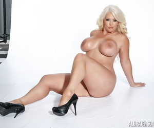 Busty MILF Alura Jenson takes off hot lingerie to show her sensual curves