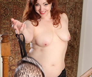 Mature BBW redhead Ember Rayne models forth the nude be required of the major majority