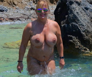 Slutty of age nudist with spacious tits Chrissy shows her hot curves in front run aground