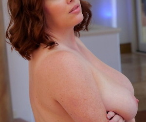Chubby mom Maggie oils her belly- big boobs- and perfectly shaved pussy