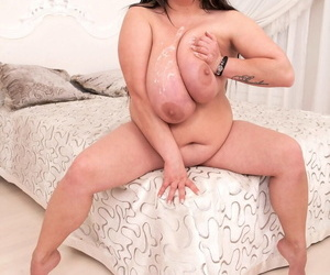 Fat & busty brunette Nila Mason inspires designer with a tit-fucking interlude