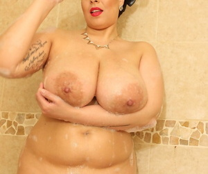 Latina Anastasia Lux washes her monster boobs and unshaved pussy in the shower
