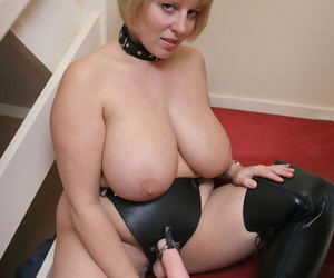 Big titted blonde BBW Curvy Claire sports a strapon cock in OTK boots