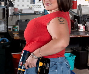 BBW Lisa Canon whips out her huge breasts in her mans tool shop