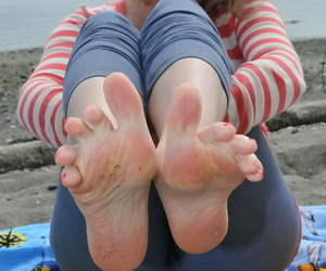 Busty mature woman Tasty Trixie goes barefoot at beach while exposing herself