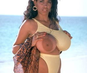 Hot busty Brazilian Angelique unveils massive melons & spreads on the beach