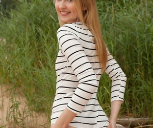 Cute teen girl Lia Kate gets unqualifiedly uncovered on a sandy lakeshore
