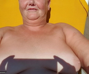 Old SSBBW Val Gasmic dyes her hair red in advance exposing herself on make an issue of beach
