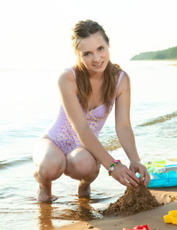 Barely legal teen Lit sheds her bathing suit to go naked on a sandy beach