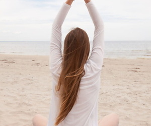 Caucasian teen Matilda Sun gets naked while doing yoga at the beach