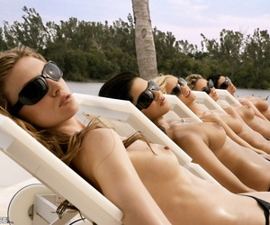 Centerfold models display their hot asses while standing naked beside a pool