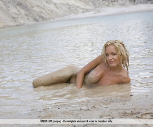 Young blonde girl Nati wanders into the water while modeling in the nude