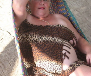 Obese nan Loudly God bares will not hear of extended tits and chubby belly on a hammock