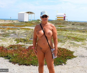 Hide older blonde In one\'s birthday suit Chrissy fishes in the buff before alluring a In one\'s birthday suit stroll
