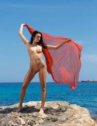 Euro brunette Sapphira A sunning her naked hot body on the beach