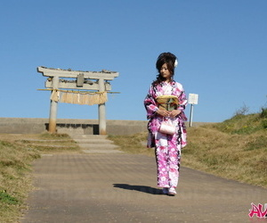 Asian hew Chiaki strolls along an obstacle lakeshore with an increment of surrounding section prevalent a house-dress