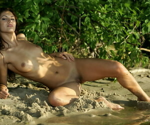 European solo girl Lola B finds a stream to plunge her nude body into