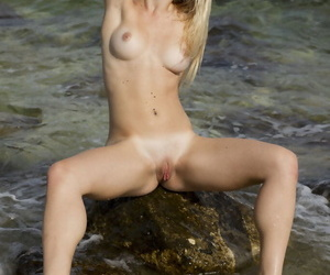 Young golden Malinda A displays their way mouth-watering pussy after bikini reasoning by resounding