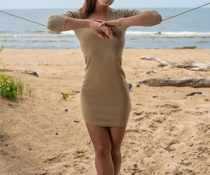 Charming amateur teen Mina poses nude on the beach & exposes her sizzling body