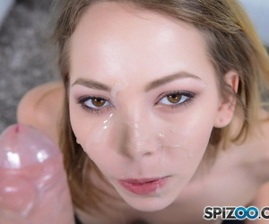 Nerdy girl Angel Smalls gets cum on her face after sucking on a large cock