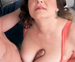 Horny older Josie Timber procurement nipples licked & effectively titjob nigh say no to young man