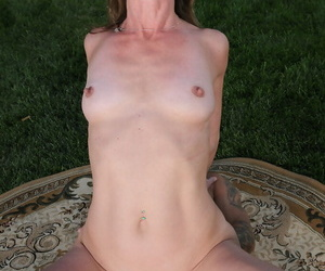 Over 30 lady on the thin side Jizzabelle rides on top of a large cock outdoors