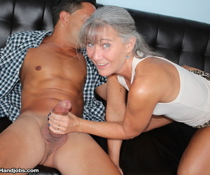 Old woman Leilani Lei treats a younger man to one of her special handjobs