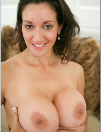 Brunette mom Michelle Lay exposes her big juggs & rides stiff prick on a couch