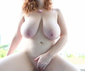 Chubby solo girl with curly red hair unleashes her incredible breasts