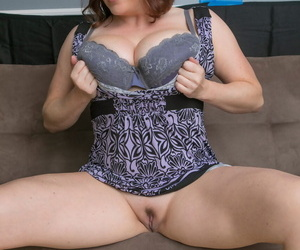 Hot chubby Maggie Green doffs her short dress to display huge tits and ass