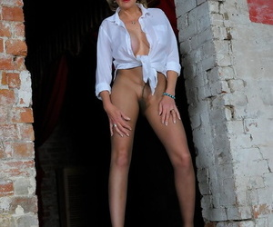 Hot mature Lady Sonia roams outside bare assed in sheer shredded pantyhose