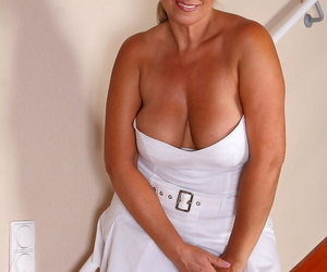 Busty mature wife Melyssa flashes panty upskirt & poses in white garter