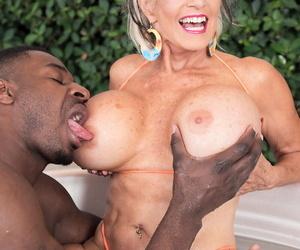 Hot granny Exhort DAngelo boob fucks a heavy black dick with their way pair