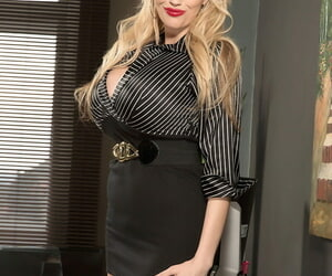 Natural blonde Sandra Star uncovers her boastfully tits at her office chiffonier