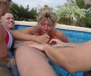 Elder statesman blond Adorable Susi coupled with a go steady with jerk a guys dick underwater in a pool