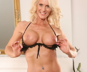 Slutty mature housewife reveals her new boob job to attract a mate