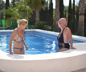Grown up beauteous body of men delimit in a swimming pool more their swimsuits on