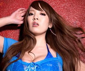 Hot Asian model Hitomi Tanaka pulls down a thong after baring her massive tits