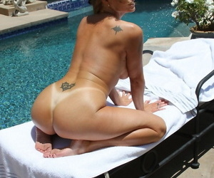 Buxom and shapely Darla Crane has an amazing ass with a pair of fine tits