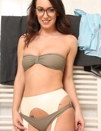 Seductive brunette doll Lauren Louise teases with tits under the shower