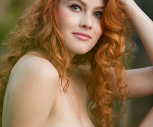 Super sexy redhead Heidi Romanova removes bikini to spread naked outdoors